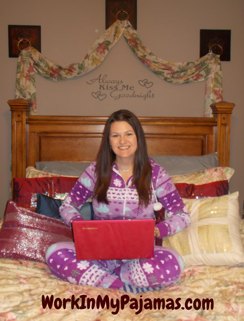 Picture of Kim Rowley sitting in bed in her pyjamas with a red laptop on her lap
